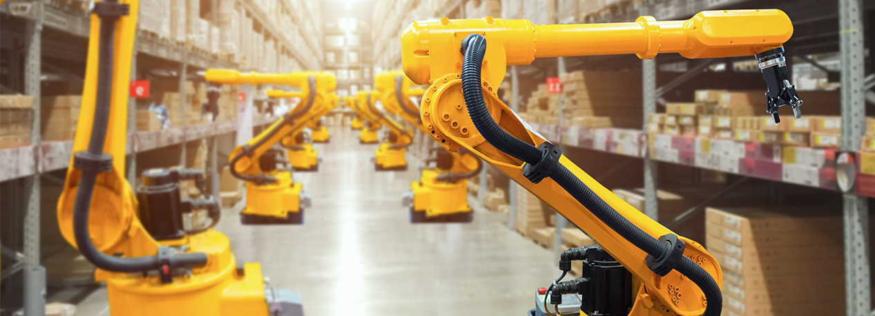 Yellow work robots on a warehouse floor