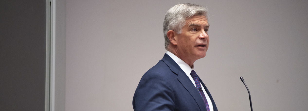 Federal Reserve Bank of Philadelphia President Patrick Harker standing at a podium