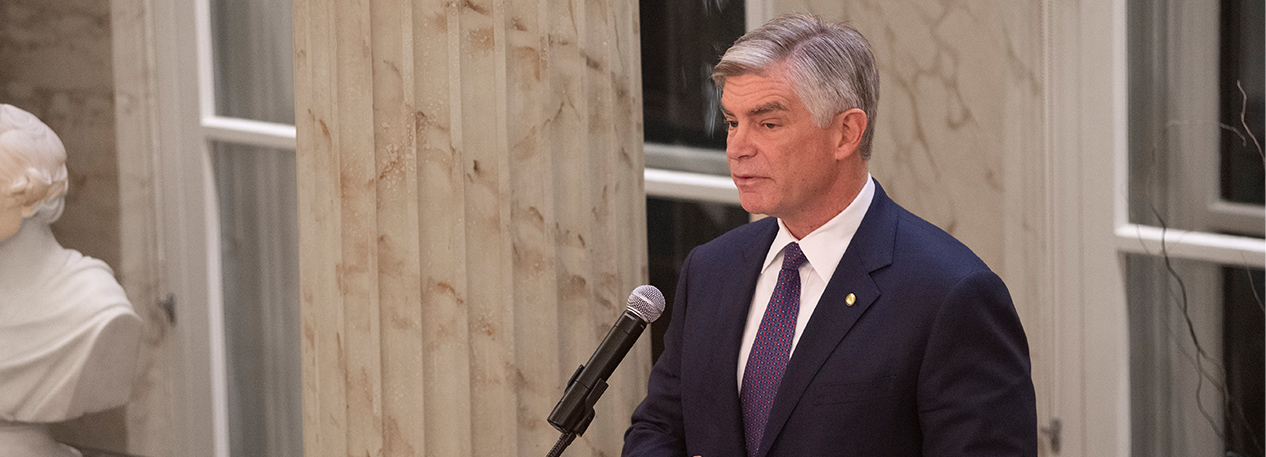 Federal Reserve Bank of Philadelphia President Patrick Harker speaking into a microphone