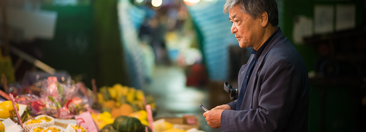 Man looking at fruit in a market