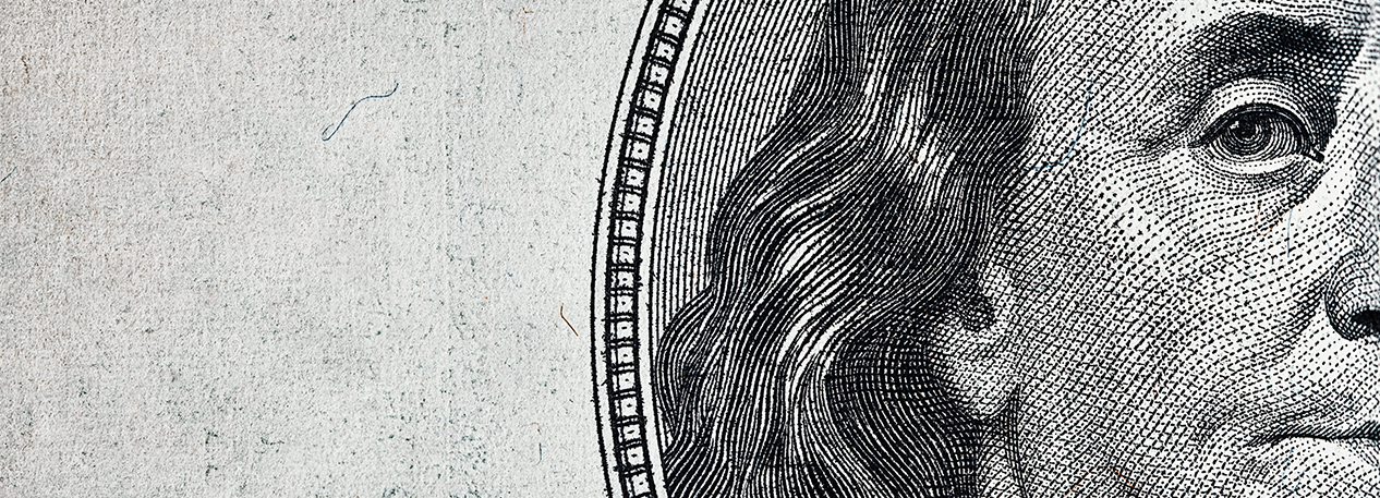 Close-up of Benjamin Franklin's portrait on the hundred-dollar bill