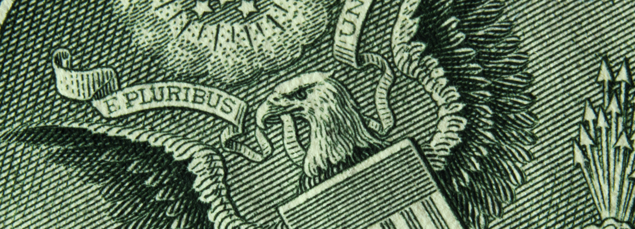 Close-up of the Great Seal of the United States on a dollar bill