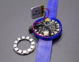 This digital tracker watch was created for City Streets participants by Stephen Pettus, a Temple University student who participates in the Creative Tech Works Design Studio (CTW) program in Philadelphia.