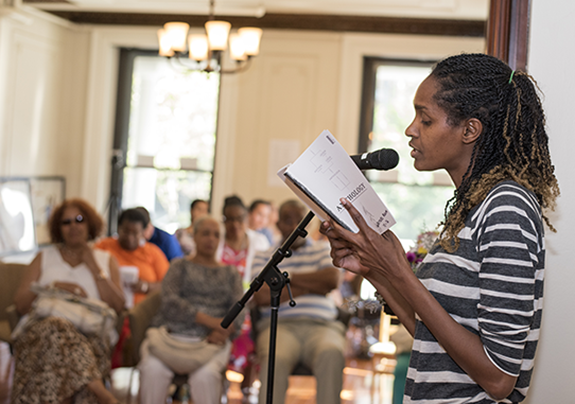 A local writer reads her work at an event for writers at Drexel University's Dornsife Center for Neighborhood Partnerships.